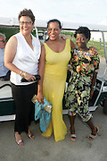 Water Mill, New York: (L-R) Poet Elizabeth Alexander, Photographic Artist Carrie Mae Weems and Thelma Golden, Chief Curator, The Studio Museum in Harlem attend the RUSH Philanthropic Arts Foundation 15th Annual Art For Life Benefit Gala held in the Hamptons at the Farmview Farms on July 26, 2014  in Water Mill, New York. (Terrence Jennings)