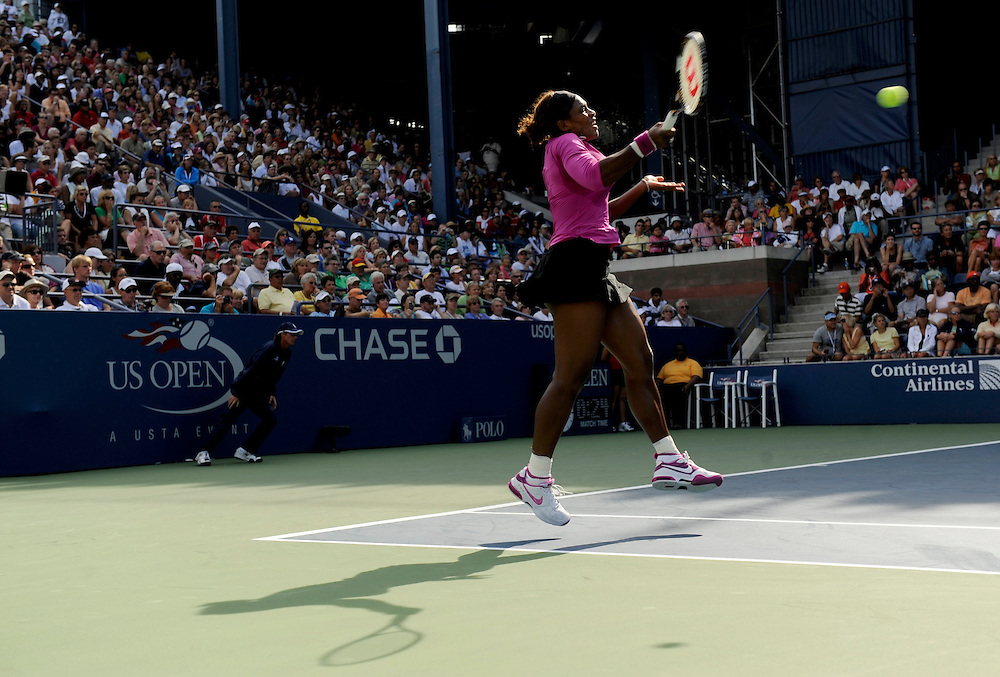 NEW YORK - SEPTEMBER 03: Serena Williams returns a ball to the team of Julia Goerges and Arantxa Parra Santonja during day four of the 2009 U.S. Open at the USTA Billie Jean King National Tennis Center on September 3, 2009 in Flushing neighborhood of the Queens borough of New York City.(Photo by Rob Tringali) *** Local Caption *** Serena Williams