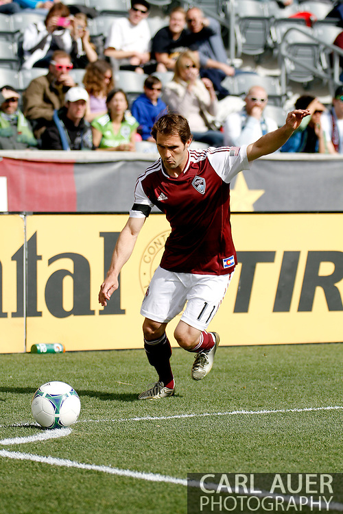 April 20th, 2013 Commerce City, CO - Colorado Rapids midfielder Brian Mullan (11) sets for a corner kick attempt in the first half of action of the MLS match between the Seattle Sounders FC and the Colorado Rapids at Dick's Sporting Goods Park in Commerce City, CO
