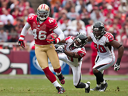 October 11, 2009; San Francisco, CA, USA;  San Francisco 49ers tight end Delanie Walker (46) is tackled by Atlanta Falcons cornerback Christopher Owens (21) on a kick off return in the second quarter at Candlestick Park. Atlanta won 45-10.