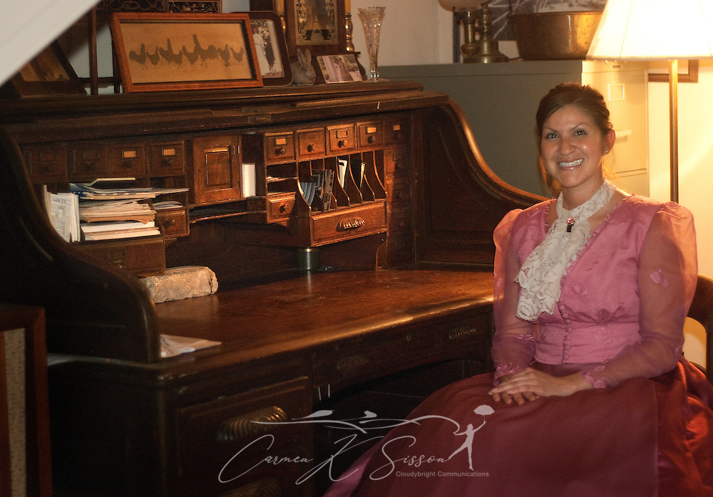 Jessica Soto sits at an antique desk at Riverview, a historic home in Columbus, Miss., April 17, 2010. The 1850 Greek Revival home was among nearly two dozen sites on tour during Columbus' annual Spring Pilgrimage. (Photo by Carmen K. Sisson/Cloudybright)