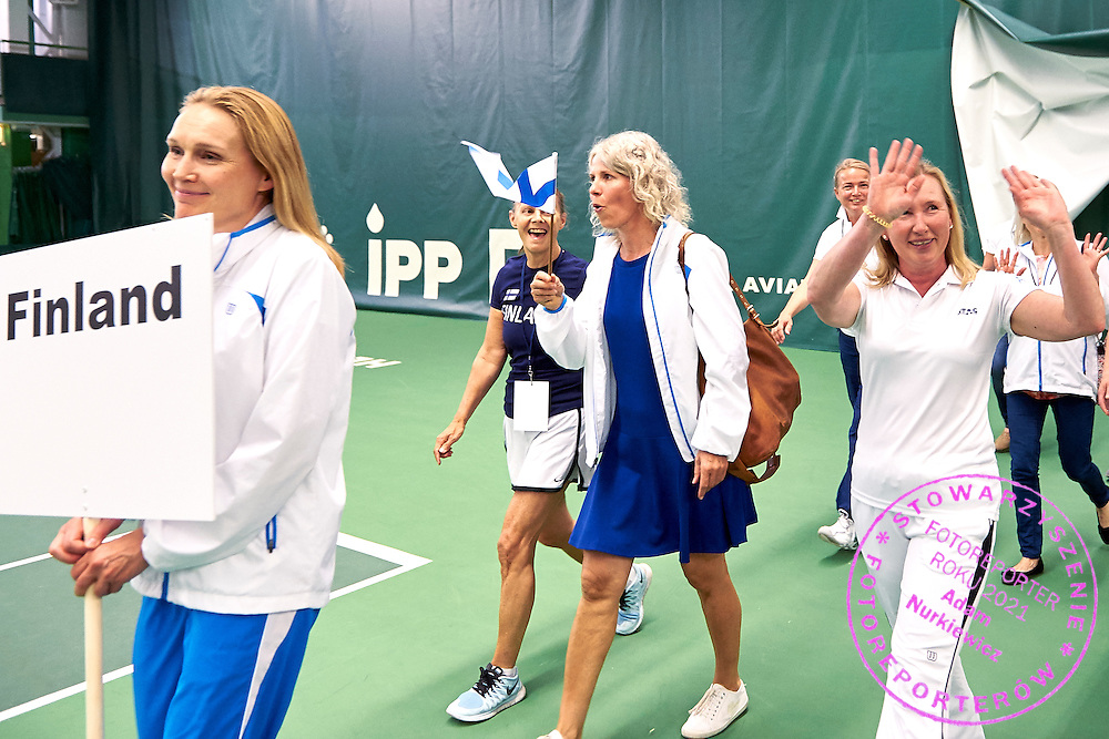 Helsinki, Finland - 2016 June 25: Finnish team walk while opening ceremony during 36th ITF Seniors World Individual Championships 2016 at Talin Tenniskeskus on June 25, 2016 in Helsinki, Finland.<br /> <br /> Adam Nurkiewicz declares that he has no rights to the image of people at the photographs of his authorship.<br /> <br /> Picture also available in RAW (NEF) or TIFF format on special request.<br /> <br /> Any editorial, commercial or promotional use requires written permission from the author of image.<br /> <br /> Mandatory credit:<br /> Photo by &copy; Adam Nurkiewicz