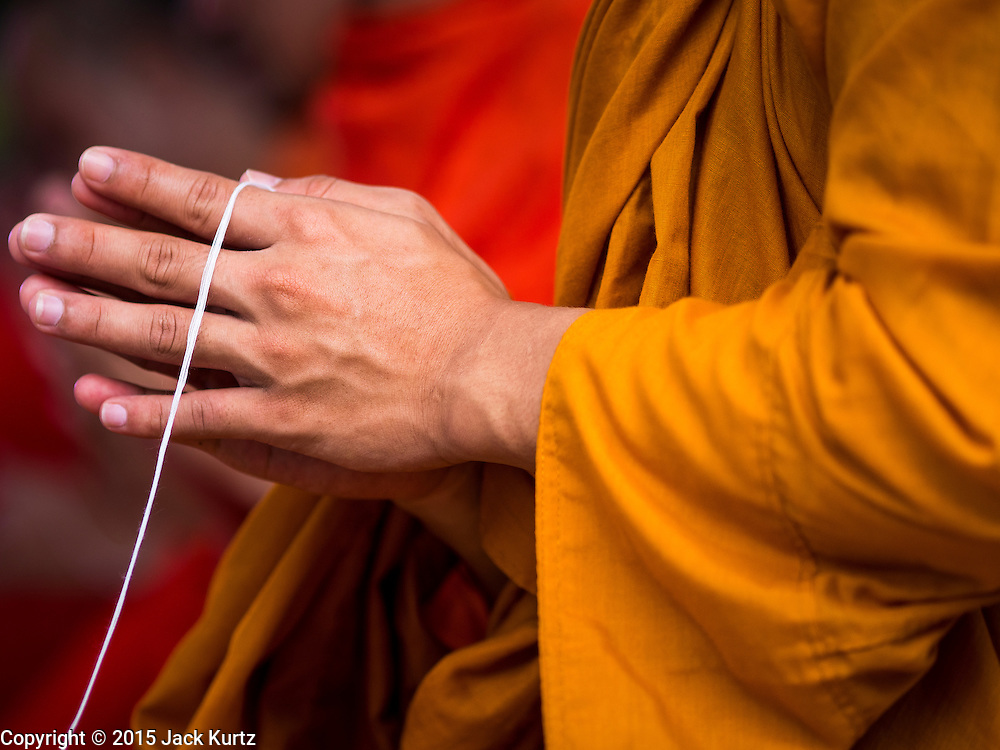 11 AUGUST 2015 - BANGKOK, THAILAND:       A Buddhist monk at a service to honor Queen Sirikit of Thailand before her 83rd birthday. Queen Sirikit was born Mom Rajawongse Sirikit Kitiyakara on August 12, 1932. She is the queen consort of Bhumibol Adulyadej, King (Rama IX) of Thailand. She met Bhumibol in Paris, where her father was the Thai ambassador. They married in 1950, she was appointed Queen Regent in 1956. The King and Queen had one son and three daughters. She has not made any public appearances since her hospitalization in 2012. Her birthday is celebrated as Mother's Day in Thailand, schools and temples across Thailand hold ceremonies to honor the Queen and mothers.PHOTO BY JACK KURTZ