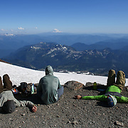 Climbers relax during a stop at Camp Muir during a summit of Mount Rainier on June 30, 2015. The iconic Pacific Northwest volcano is a popular challenge for mountaineers.  (Joshua Trujillo, seattlepi.com)