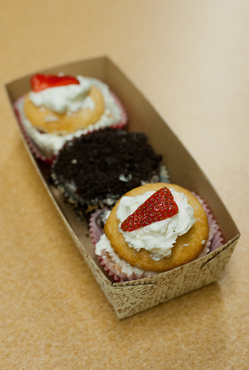 Strawberry Shortcake (front and back) and Cookies and Creme cupcakes made by Ohio University student Karris Barclay, baker and owner of Krave it! cupcakes. Barclay, a freshman from Akron majoring in Special Education, began baking as a stress-reliever in high school.
