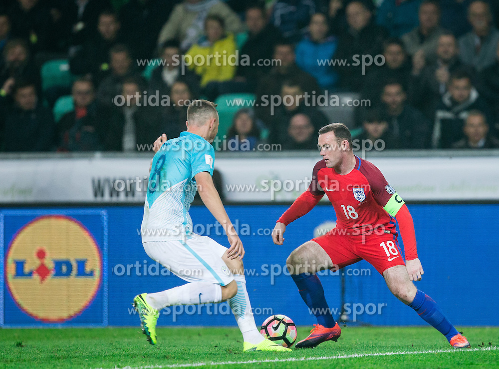 Jasmin Kurtic of Slovenia vs Wayne Rooney of England during football match between National teams of Slovenia and England in Round #3 of FIFA World Cup Russia 2018 Qualifier Group F, on October 11, 2016 in SRC Stozice, Ljubljana, Slovenia. Photo by Vid Ponikvar / Sportida