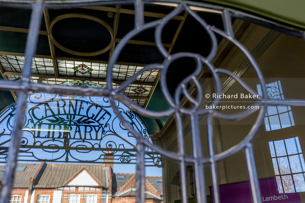 Edwardian period entrance of the re-opened Carnegie Library on Herne Hill in south London which has opened its doors for the first time in almost 2 years, on 15th February 2018, in London, England. Closed by Lambeth council and occupied by protesters for 10 days in 2016, the library bequeathed by US philanthropist Andrew Carnegie has been locked ever since because, say Lambeth austerity cuts are necessary. A gym that locals say they don't want or need has been installed in the listed basement and actual library space a fraction as before and it's believed no qualified librarians will be present to administer it. Protesters also believe this community building will ultimately sold off by Lambeth council for luxury homes.
