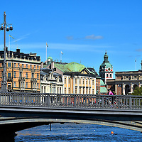 Vasabron Bridge in Stockholm, Sweden<br /> Since 1878, the Vasabron bridge, whose namesake is King Gustav Vasa, has spanned over the Norrström to connect the Old Town of Gamla stan with the Norrmalm district shown here. The buildings on the left run along Strömgatan street. Visible on the right are the dome of Sankt Jacobs Kyrka and the Royal Swedish Opera House.