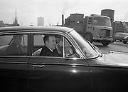 Mr. Neill Blaney, Minister for Local Government, takes the wheel to complete the new driving test, under one of the newly appointed examiners..23.03.1964