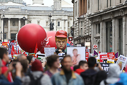 © Licensed to London News Pictures. 04/06/2019. London, UK. Crowds gather in Trafalgar square this morning ahead of a protest against President Donald Trumps state visit to the UK. Photo credit: Andrew McCaren/LNP