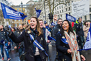 Passions rise as the march passes Downing Street. The NUT leads a national strike action in England and Wales. Marches and rallies are being held around the country, including this one from Broadcasting House to Downing Street, Whitehall. The union says the action is being taken against: Excessive workload and bureaucratic; Performance related pay and in defence of a national pay scale system; Unfair pension changes. Christine Blower, General Secretary of the National Union of Teachers, the largest teachers&rsquo; union said: &ldquo;Teachers deeply regret the disruption caused by this strike action to parents and teachers. The Government&rsquo;s refusal, however, to engage to resolve the dispute means that we have no alternative other than to demonstrate the seriousness of our concerns.<br /> &ldquo;Teachers&rsquo; levels of workload are intolerable &ndash;the Government&rsquo;s own survey, published last month, shows that primary school teachers work nearly 60 hours a week and secondary school teachers work nearly 56 hours a week. 2 in 5 teachers are leaving the profession in the first 5 years of teaching as are many others.  This is bad for children and bad for education. London, UK 26 March 2014.<br />  Guy Bell, 07771 786236, guy@gbphotos.com