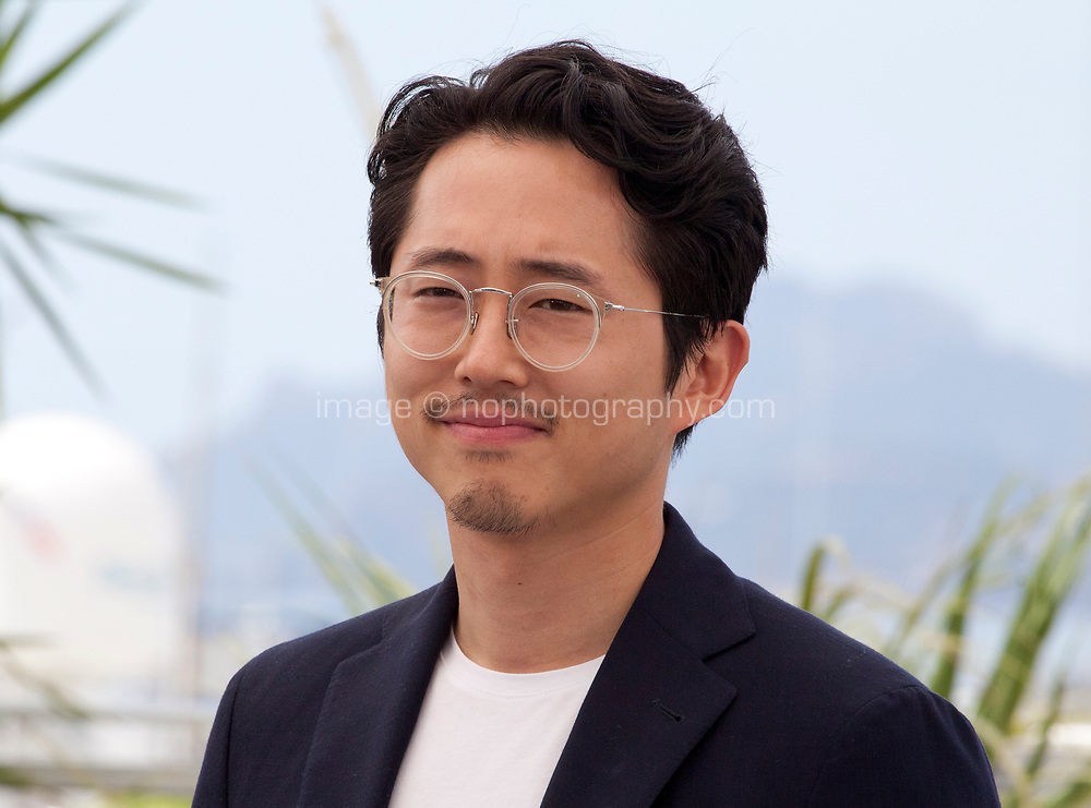 Actor Steven Yeun at the Burning film photo call at the 71st Cannes Film Festival, Thursday 17th May 2018, Cannes, France. Photo credit: Doreen Kennedy