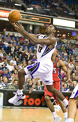 November 27, 2009; Sacramento, CA, USA;  Sacramento Kings guard Tyreke Evans (13) shoots against the New Jersey Nets during the fourth quarter at the ARCO Arena. Sacramento defeated New Jersey 109-96. Sacramento defeated New Jersey 109-96.