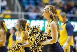 Dec 13, 2015; Morgantown, WV, USA; A West Virginia Mountaineers cheerleader performs during a timeout against the Louisiana Monroe Warhawks at WVU Coliseum. Mandatory Credit: Ben Queen-USA TODAY Sports