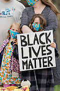 Little girl with her family protests in Caerphilly holding sign reading 'Black Lives Matter' during the Black Lives Matter protest in Caerphilly, Wales on 6 June 2020.