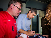 04 APRIL 2019 - CARROLL, IOWA:  BETO O'ROURKE signs a sweater for a supporter during a campaign event in Carroll, IA. Beto O'Rourke stopped at Kerps Tavern in Carroll to campaign for president Thursday. He is crisscrossing Iowa through the weekend with stops throughout the state. Iowa holds its caucuses, considered the kickoff of the US Presidential campaign, on Feb. 3, 2020.    PHOTO BY JACK KURTZ