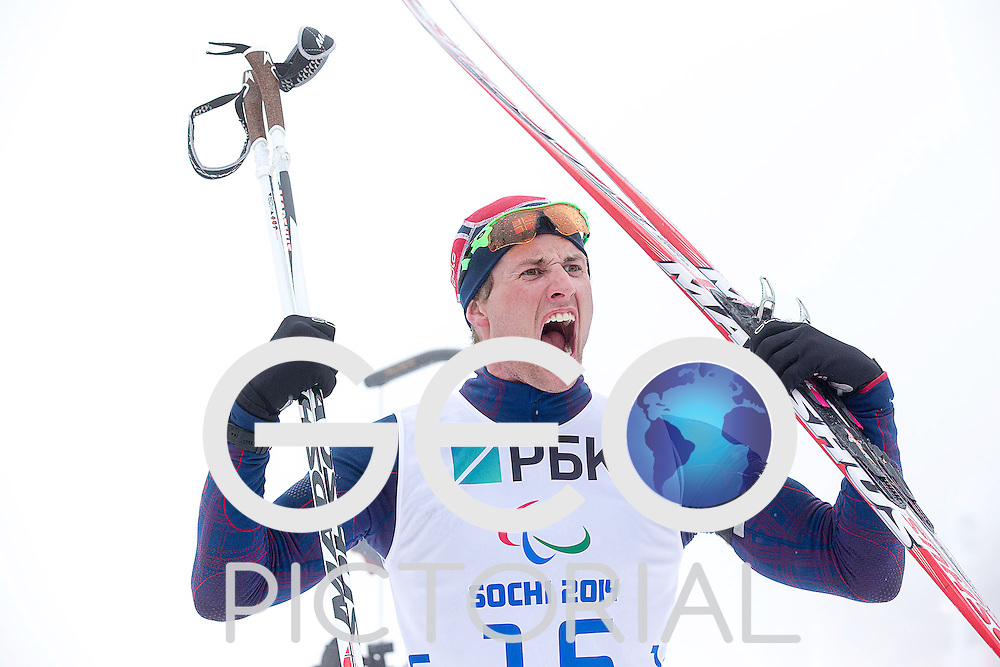 Biathlon: 2014 Sochi Winter Paralympics: Norway's Nils-Erik ULSET celebrates after crossing the finish line in the men's Biathlon 12.5 km Standing to win silver medal at the Laura Cross-Country Ski and Biathlon Center, Sochi, Russia 11/03/2014;<br /> PHOTO CREDIT: George S Blonsky