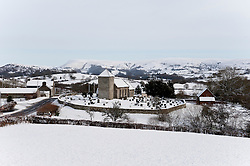 © Licensed to London News Pictures. 14/01/2015. Snowy landscape around St. David's Church in the tiny Welsh hamlet of Llanddewi' Cwm,  Powys. Snow fell last night in Mid-Wales and cold temperatures have prevented the snow from melting. Llanddewi'r Cwm, Powys , Wales, UK. Photo credit: Graham M. Lawrence/LNP