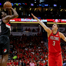 Apr 21, 2018; New Orleans, LA, USA; Portland Trail Blazers forward Al-Farouq Aminu (8) shoots over New Orleans Pelicans forward Nikola Mirotic (3) during the second half in game four of the first round of the 2018 NBA Playoffs at the Smoothie King Center. Mandatory Credit: Derick E. Hingle-USA TODAY Sports