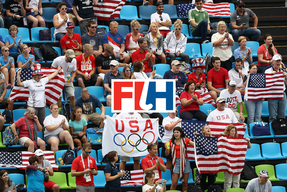 RIO DE JANEIRO, BRAZIL - AUGUST 08:  United States fans cheer against Australia during a Women's Pool B match on Day 3 of the Rio 2016 Olympic Games at the Olympic Hockey Centre on August 8, 2016 in Rio de Janeiro, Brazil.  (Photo by Sean Haffey/Getty Images)