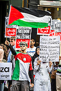 "Stop the 'massacre' in Gaza protest. They assembled at the Israeli Embassy. They called for ""Israel's bombing and killing to stop now and for David Cameron to stop supporting Israeli war crimes"". London, 01 August 2014."