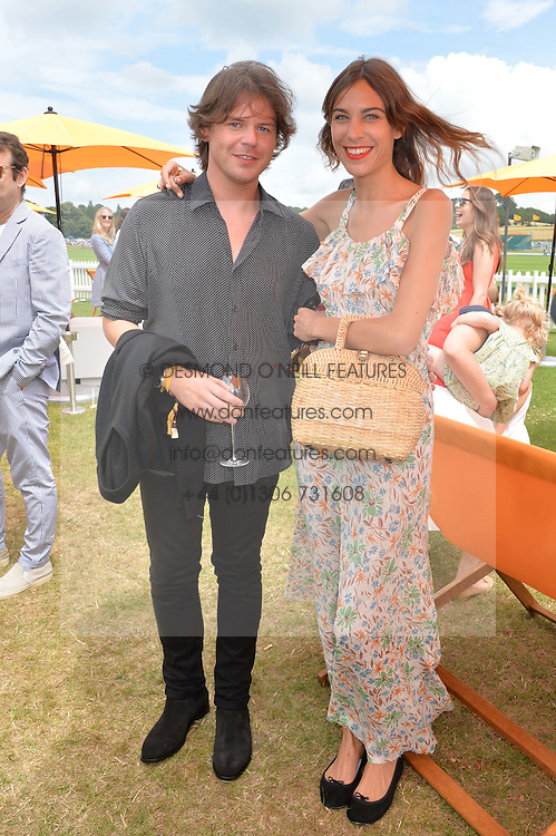 CHRISTOPHER KANE and ALEXA CHUNG at the Veuve Clicquot Gold Cup Final at Cowdray Park Polo Club, Midhurst, West Sussex on 20th July 2014.