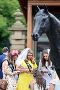 A Hen Party studies form under the nose of the Frankel statue at York Racecourse, York, United Kingdom on 26 May 2018. Picture by Mick Atkins.