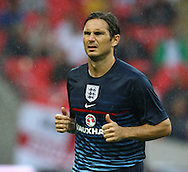 Picture by John Rainford/Focus Images Ltd +44 7506 538356<br /> 14/08/2013<br /> Frank Lampard of England warms up before the International Friendly match at Wembley Stadium, London.
