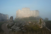 LES ANDELEYS, FRANCE - OCTOBER 10: View of the embossed rampart of the Chateau Gaillard in a fog, on October 10, 2008 in Les Andelys, Normandy, France. The chateau was built by Richard the Lionheart in 1196, came under French control in 1204 following a siege in 1203. It was later destroyed by Henry IV in 1603 and classified as Monuments Historiques in 1852. (Photo by Manuel Cohen)