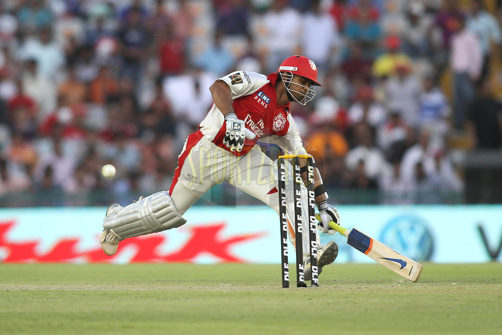 Paul Valthaty of the Kings XI Punjab scrambles to make his ground during match 9 of the Indian Premier League ( IPL ) Season 4 between the Kings XI Punjab and the Chennai Super Kings held at the PCA stadium in Mohali, Chandigarh, India on the 13th April 2011..Photo by Shaun Roy/BCCI/SPORTZPICS