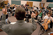 16282Founders Day Performance Practice..Johnny Hanson Photo..Ohio University maestro, Andrew George, conducts a practice, Monday afternoon, Feb., 9, in the School of Music building for the Bicentennial Founders Day performance.