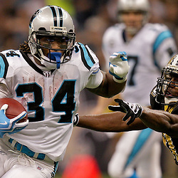 Nov 08, 2009; New Orleans, LA, USA; Carolina Panthers running back DeAngelo Williams (34) avoids New Orleans Saints linebacker Jonathan Vilma (51) on a run in the third quarter at the Louisiana Superdome. The Saints defeated the Panthers 30-20. Mandatory Credit: Derick E. Hingle