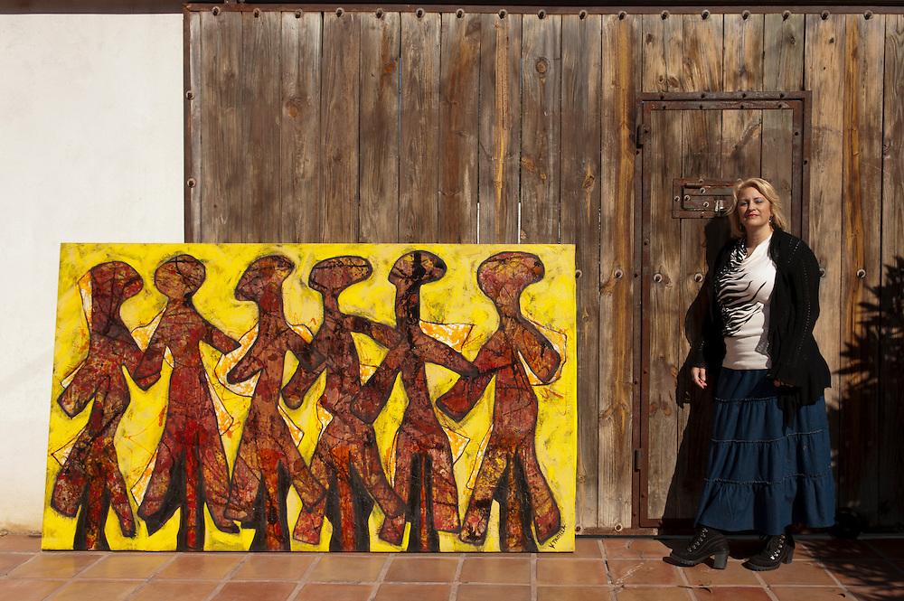 Painter Veronica Padilla at a friends house in Nuevo Laredo, Tamaulipas, Mexico.<br /> <br /> &copy; Stefan Falke   <br /> www.stefanfalke.com<br /> La Frontera: Artists along the US Mexican Border