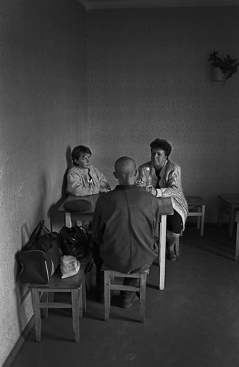Russian young prisoner meets with his relatives in the room for meeting at the colony for prisoner's children in Siberian town Leninsk-Kuznetsky, Russia, 16 October 2000.