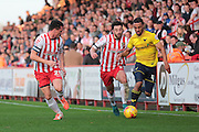 Stevenage FC defender Ronnie Henry and Stevenage FC midfielder Chris Whelpdale chase Oxford United midfielder Kemar Roofe during the Sky Bet League 2 match between Stevenage and Oxford United at the Lamex Stadium, Stevenage, England on 31 October 2015. Photo by Jemma Phillips.