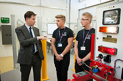 © Licensed to London News Pictures.  11/12/2014. Taunton, Somerset, UK.  Deputy Prime Minister Nick Clegg visits the automotive workshop at Somerset College to see its apprenticeship programme in action. it was announced earlier this week that the Liberal Democrats have fulfilled their commitment to starting 2 million apprenticeships this parliament.  Photo credit : Simon Chapman/LNP