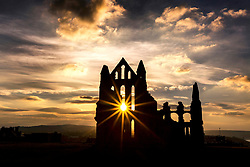 © Licensed to London News Pictures. 23/03/2018. Whitby UK. The sun shines through the vast windows in the Sanctuary of the 13th century ruin of Whitby Abbey that inspired Bram Stoker's Dracula on the Yorkshire coast at sunset last night. Photo credit: Andrew McCaren/LNP
