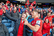Dan Goggin (#23) of Munster Rugby poses for selfies with the Munster supporters after the final whistle of the Heineken Champions Cup quarter-final match between Edinburgh Rugby and Munster Rugby at BT Murrayfield Stadium, Edinburgh, Scotland on 30 March 2019.