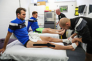 Forest Green Rovers Christian Doidge(9) and Forest Green Rovers Mark Roberts(21) get some pre match strapping during the EFL Sky Bet League 2 match between Forest Green Rovers and Newport County at the New Lawn, Forest Green, United Kingdom on 14 October 2017. Photo by Shane Healey.