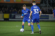 AFC Wimbledon Jack Rudoni (12) about to pass to AFC Wimbledon midfielder Callum Reilly (33) during the EFL Sky Bet League 1 match between AFC Wimbledon and Burton Albion at the Cherry Red Records Stadium, Kingston, England on 28 January 2020.