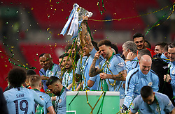 Manchester City's Danilo (centre) lifts the trophy after winning the Carabao Cup Final in the penalty shoot out