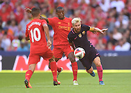 Gerogino Wijnaldum of Liverpool and Lionel Messi of FC Barcelona during the International Champions Cup match at Wembley Stadium, London<br /> Picture by Andrew Timms/Focus Images Ltd +44 7917 236526<br /> 06/08/2016