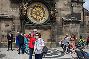 Visitors documenting themselves with a smart phone on a selfie stick at Old Town Square in Prague. One of the main attractions on the square is The Prague astronomical clock, or Prague orloj (Czech: Pražský orloj) which is a medieval astronomical clock. The clock was first installed in 1410, making it the third-oldest astronomical clock in the world and the oldest one still operating.