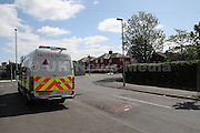 14.05.2016 Manchester UK: Police  officers at the scene in Longsight where its thought that a teenager sustained a gunshot wound. Police can be seen searching with a sniffer dog and  Tactical Aid unit officers were searching bins and a back street in Farrer Street