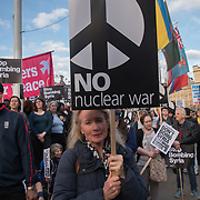Stop the War Coalition organise a protest against air strikes in Syria and violate international law  is attended by several hundred people in Parliament Square, London, UK
