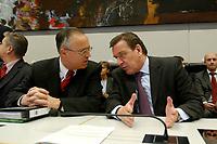 17 DEC 2002, BERLIN/GERMANY:<br /> Hans Eichel (L), SPD, Bundesfinanzminister, und Gerhard Schroeder (R), SPD, Bundeskanzler, im Gespraech, vor Beginn der Sitzung der SPD Bundestagsfraktion, Deutscher Bundestag<br /> IMAGE: 20021217-01-019<br /> KEYWORDS: Fraktionssitzung, Gerhard Schröder,  Gespäch