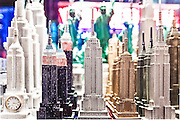 Roughly-made Empire State Building and Statue of Liberty statuettes in a souvenir shop near New York's Times Square.