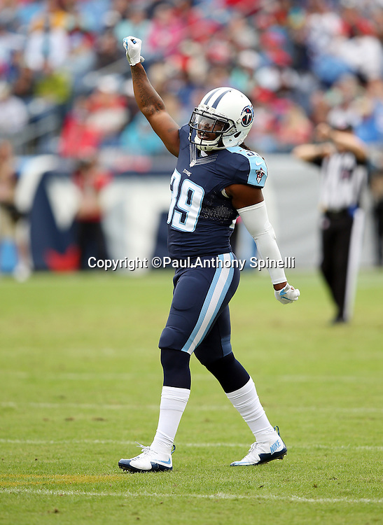 Tennessee Titans strong safety Daimion Stafford (39) raises his fist signaling fourth down during the 2015 week 7 regular season NFL football game against the Atlanta Falcons on Sunday, Oct. 25, 2015 in Nashville, Tenn. The Falcons won the game 10-7. (©Paul Anthony Spinelli)