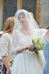 The Bride PRINCESS FLORENCE VON PREUSSEN at the wedding of Princess Florence von Preussen second daughter of Prince Nicholas von Preussen to the Hon.James Tollemache youngest son of the 5th Lord Tollemache held at the Church of St.Michael & All Angels, East Coker, Somerset on 10th May 2014.