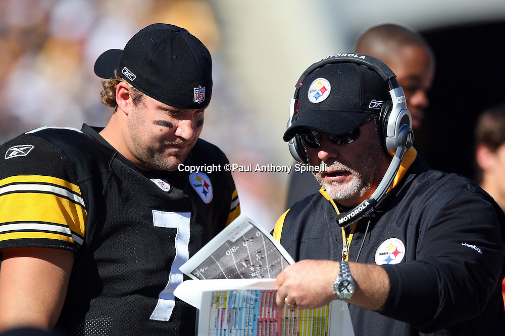 Pittsburgh Steelers quarterback Ben Roethlisberger (7) looks at play photographs with one of the Steelers coaches during the NFL football game against the Minnesota Vikings, October 25, 2009 in Pittsburgh, Pennsylvania. The Steelers won the game 27-17. (©Paul Anthony Spinelli)